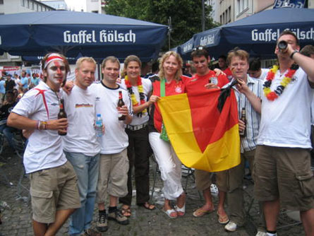 Football fans from Germany and England celebrate in Cologne during the 2006 World Cup Finals