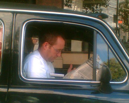 A candid camera shot of a cabbie