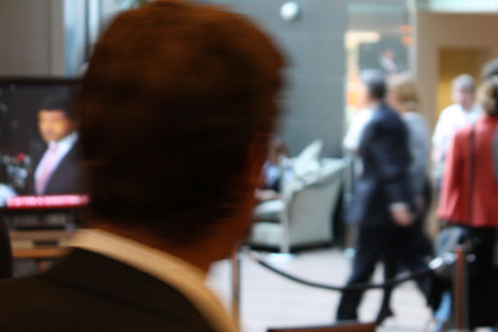 The Prime Minister in the foyer, and the screen, and someone's head