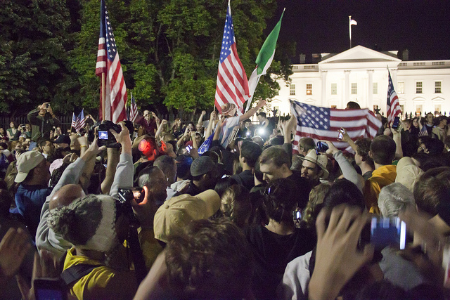 Crowds assemble to celebrate the death of Osama bin Laden, 1st May 2011. Photo by thisisbossi on Flickr.
