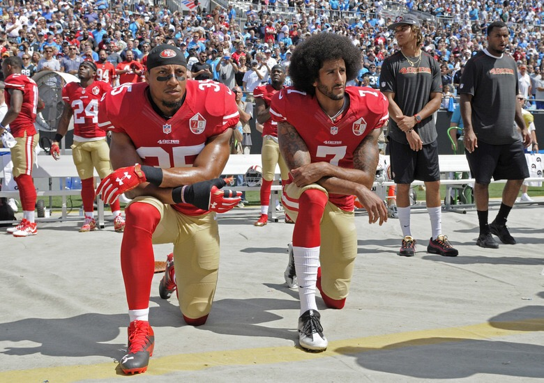 Colin Kaepernick (right) and Eric Reid were the forefathers of the recent protest movement of taking a knee during the national anthem. (Mike McCarn/AP)